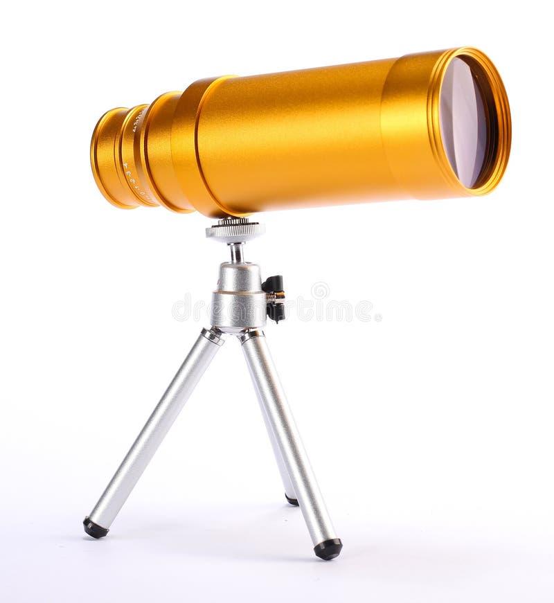 Guld- teleskop arkivbild