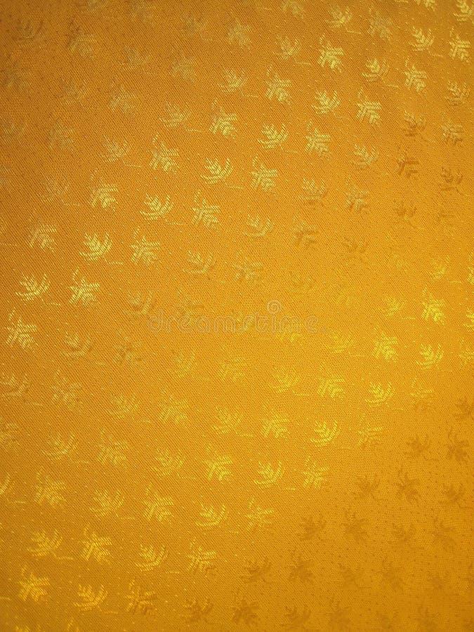 guld- textur för tyg arkivbild
