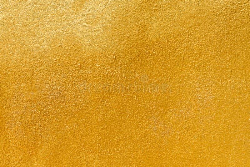 Guld- texturbakgrundsmellanrum f?r design arkivfoton