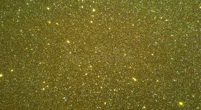Guld- texturerad bakgrund med blänker effektbakgrund fotografering för bildbyråer
