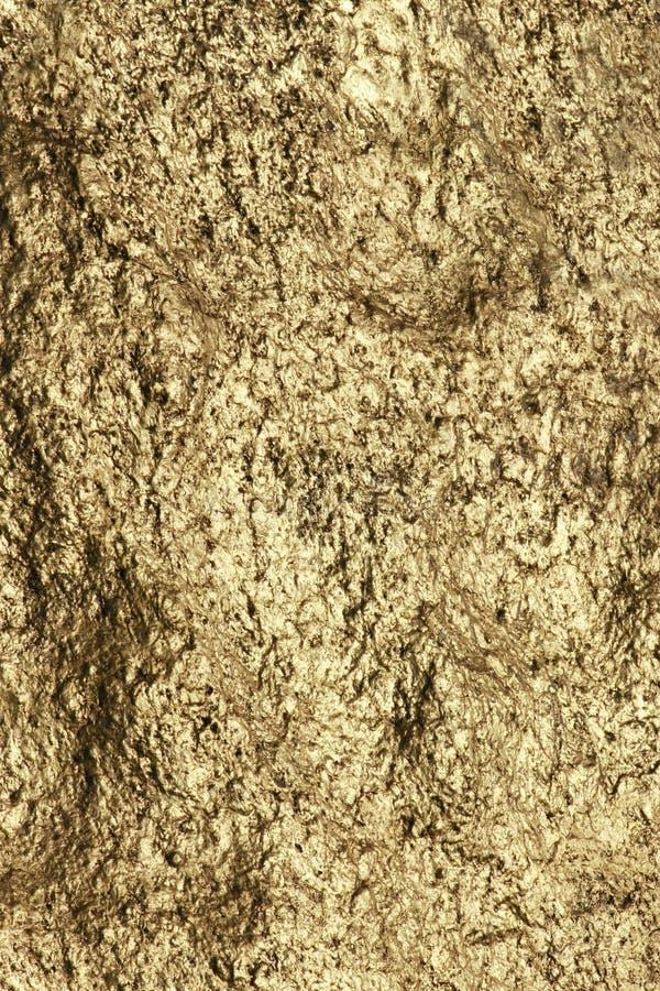 guld- texturvägg royaltyfri fotografi