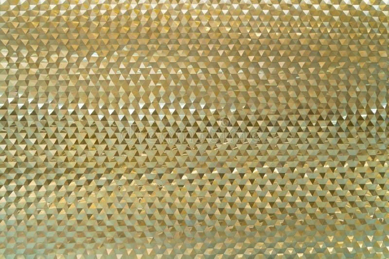Guld- triangeltegelplattor texturerar, mönstrar grafisk bakgrund royaltyfri foto