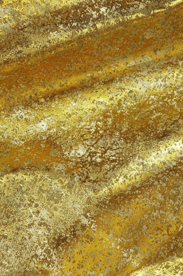 Guld- tyg arkivbilder