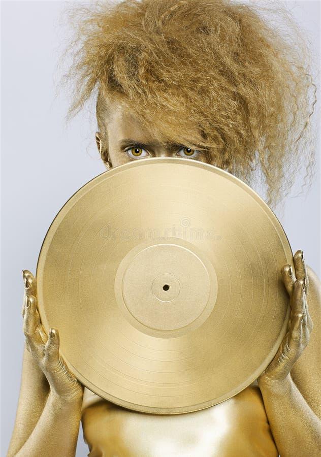 guld- vinyl för flicka royaltyfria foton
