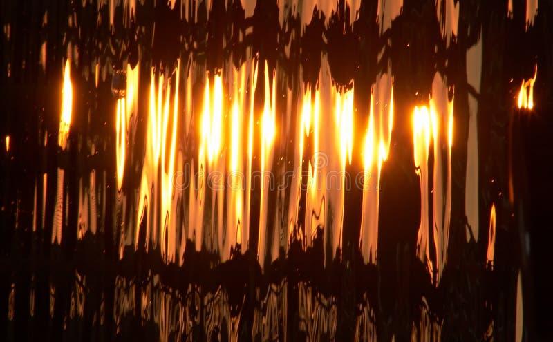 Download Guldflytande fotografering för bildbyråer. Bild av reflektera - 185963