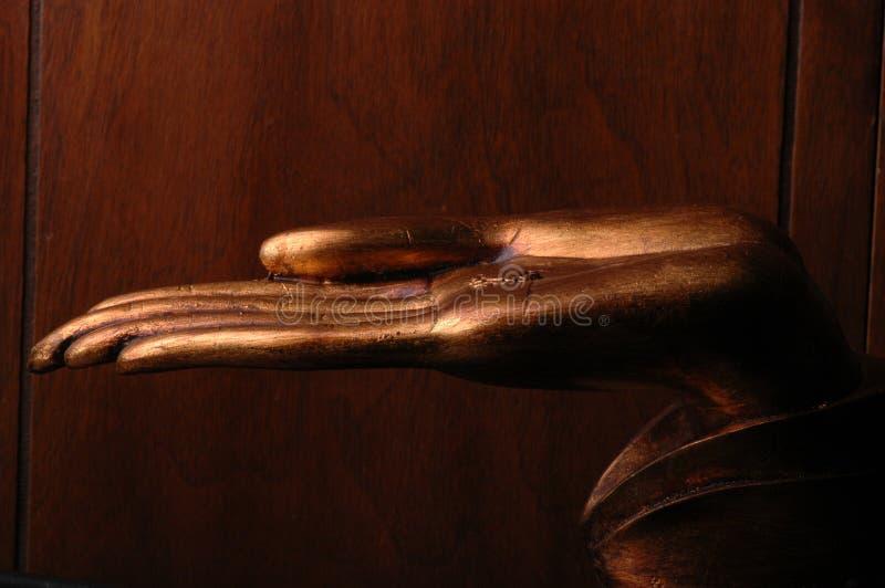 guldhanden sculpted royaltyfri foto