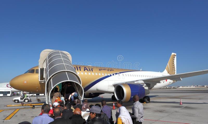 Gulf Air aircraft boarding. Manama, Bahrain stock photography