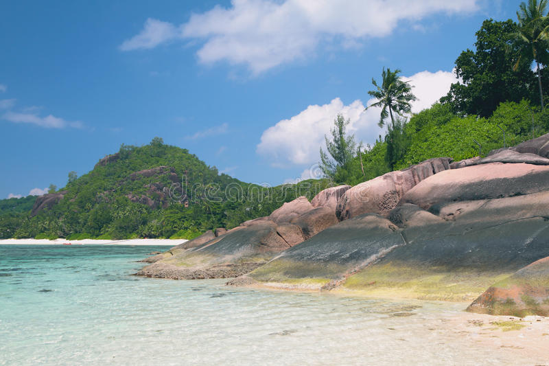Gulf and basalt educations in tropics. Baie Lazare, Mahe, Seychelles stock photography
