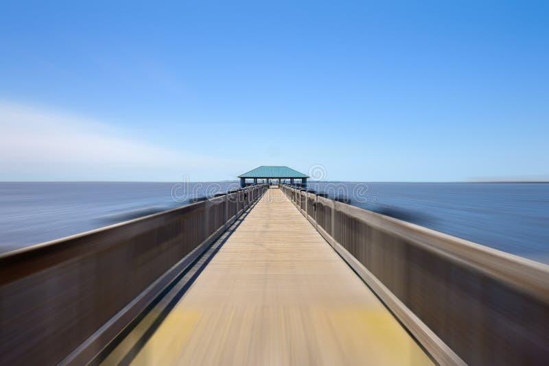 Ocean Springs Beach Pier. Gulf coast beach pier in Ocean Springs, Mississippi with motion blur stock image