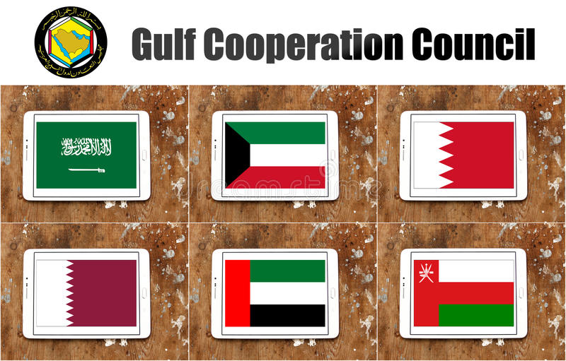 Gulf cooperation council flags. Flags of countries of gulf cooperation council on white tablet on rusty wooden background. the countries are Bahrain, Kuwait vector illustration