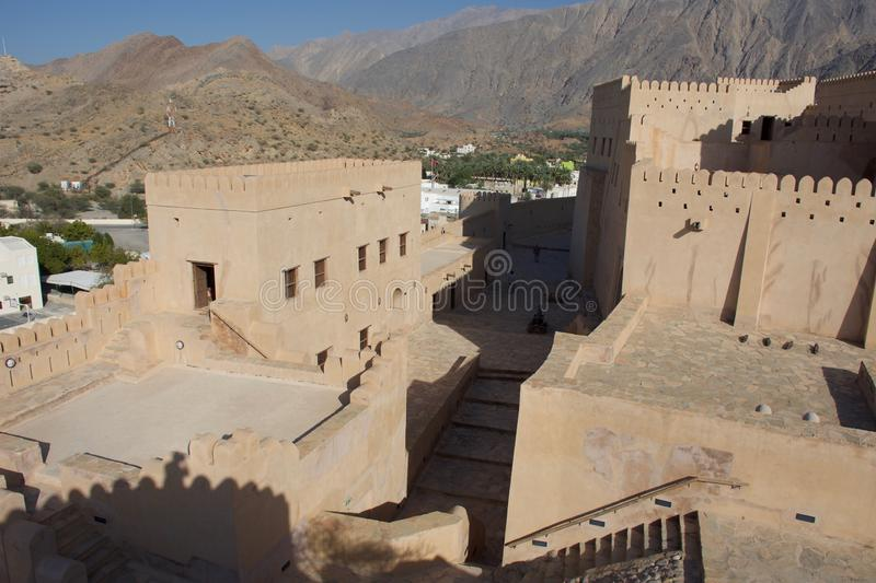 The Gulf is littered with ancient forts throughout the region. This Omani fortress in the mountains with a fantastic vi. The Gulf is littered with ancient forts stock photos