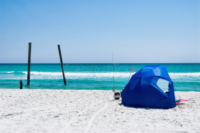 Gulf of Mexico along the Emerald Coast with Beach Tent. Camp Helen State Park pier in Panama City Beach Florida. There is a beach tent set up in the white sand royalty free stock photos