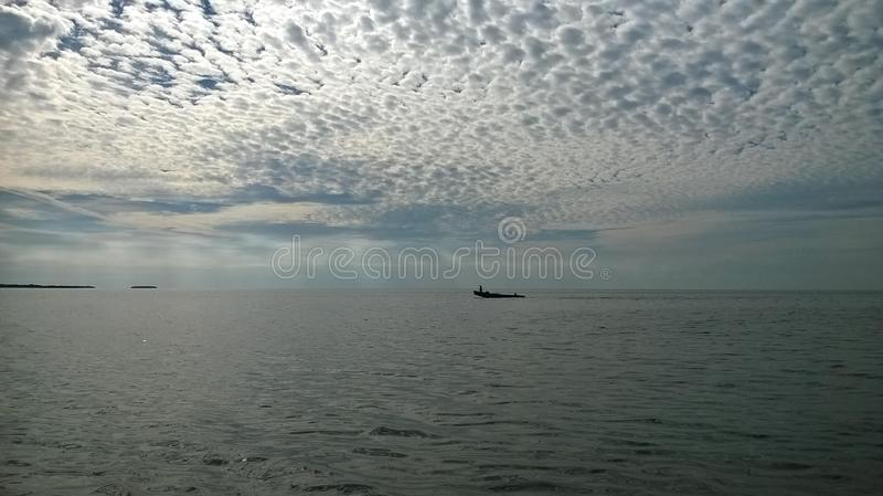 Gulf of Mexico with well boat beautiful sky and clouds royalty free stock image