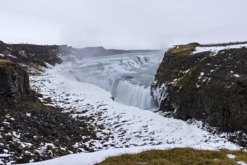 Gullfoss waterfall from Reykjavik in Iceland. A half frozen triangle as the Hvita River falls into a wintry gorge in Western royalty free stock photo