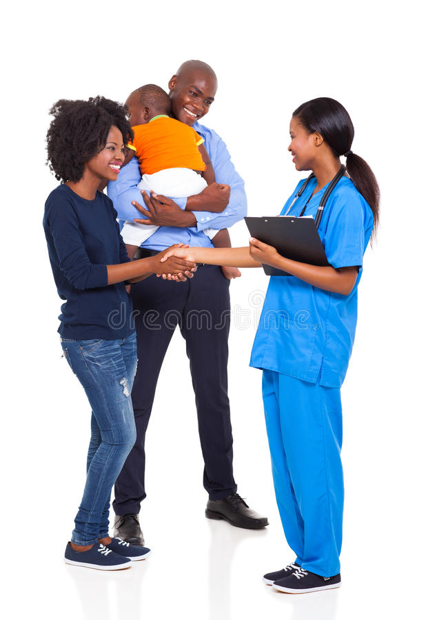 Afrikansk familjsjuksköterska royaltyfri foto