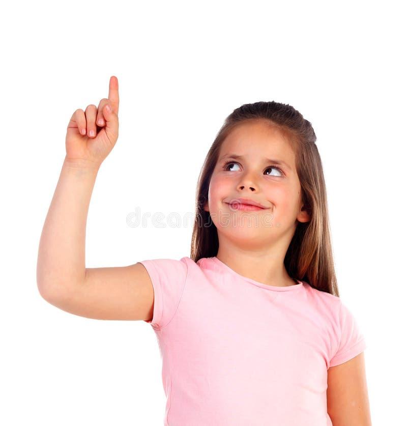 Gullig barnflicka som pekar med hans finger fotografering för bildbyråer