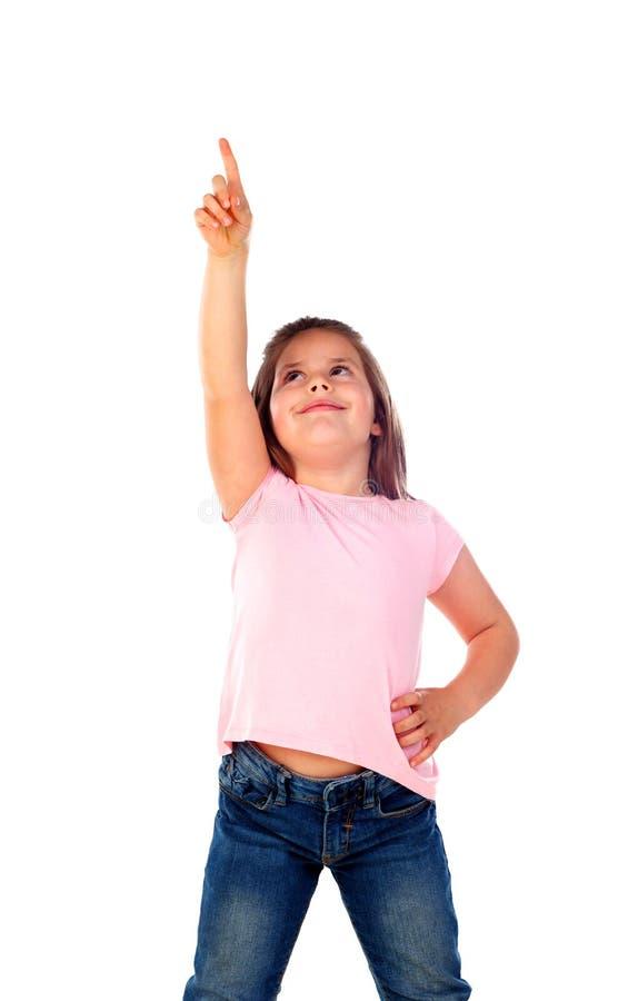 Gullig barnflicka som pekar med hans finger arkivbild