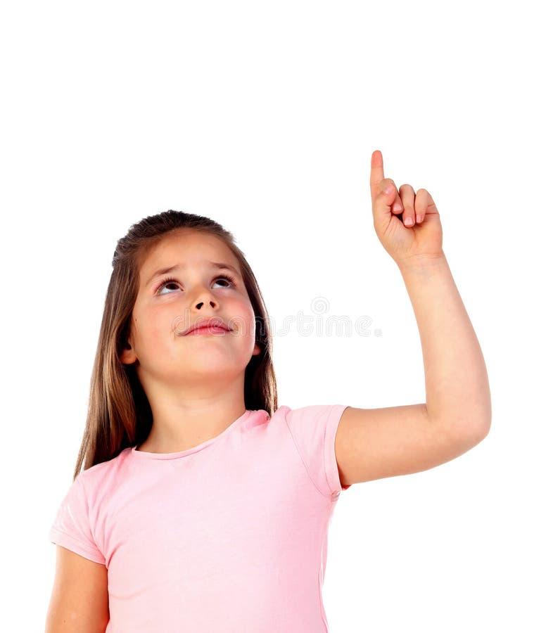 Gullig barnflicka som pekar med hans finger royaltyfri bild