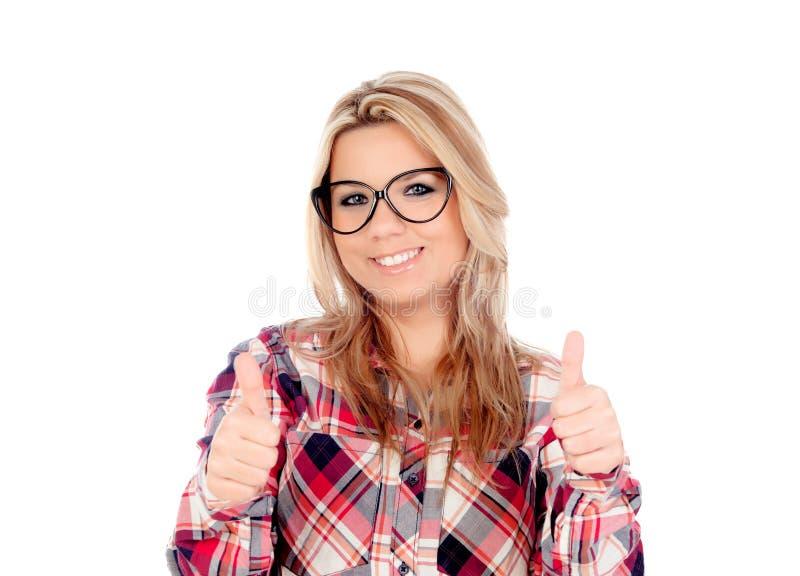 Gullig blond flicka med exponeringsglas som Ok säger royaltyfri foto