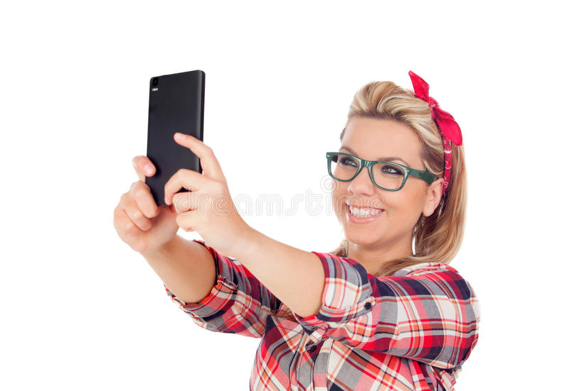 Gullig blond flicka som får ett foto royaltyfri foto