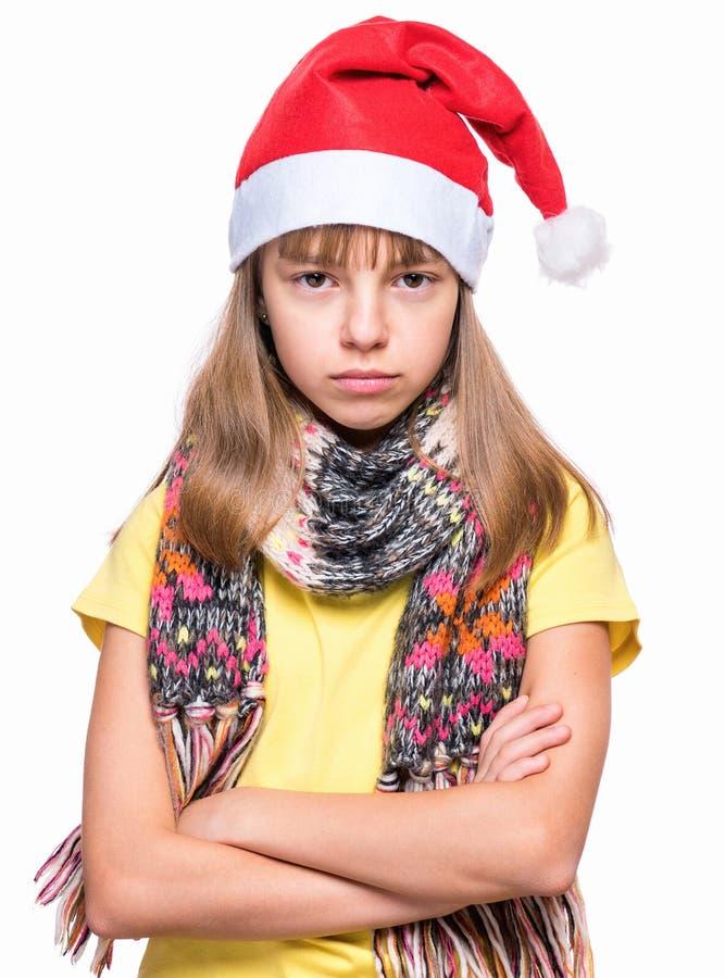 Gullig flicka som bär den Santa Claus hatten royaltyfri foto