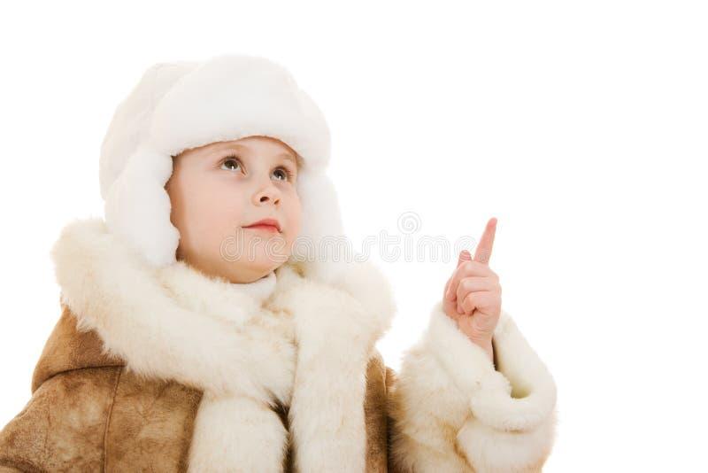 gullig flickahatt för lag som ser upp sheepskinen royaltyfria foton