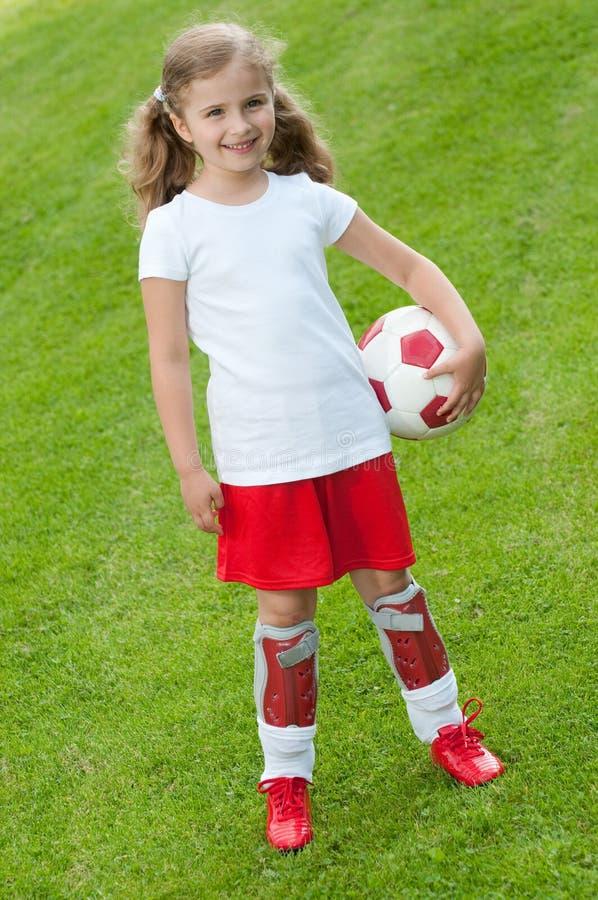Gullig fotbollspelare royaltyfri bild