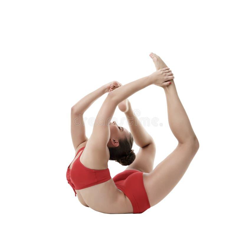 Gullig gymnast som gör övning Isolerat på vit arkivbild