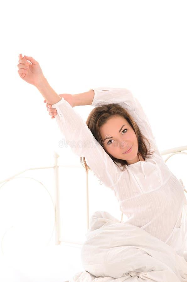 Gullig kvinna som sträcker sig efter sömn royaltyfria foton