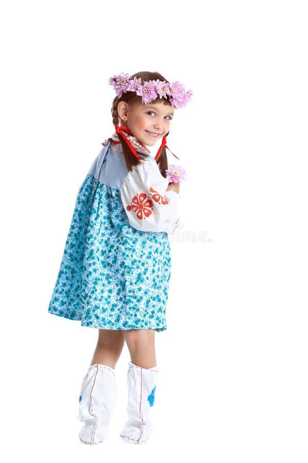 Gullig liten flicka i blå slavicdräkt fotografering för bildbyråer