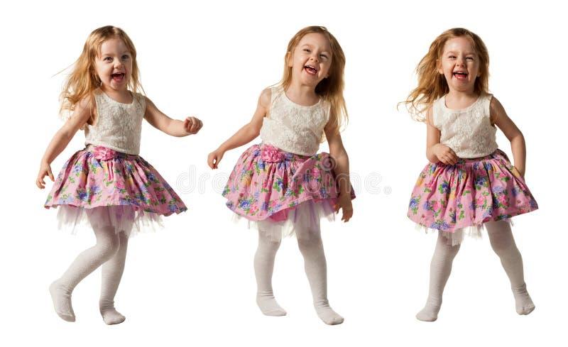 Gullig liten flickaspring med glädje som isoleras på vit bakgrund royaltyfri foto