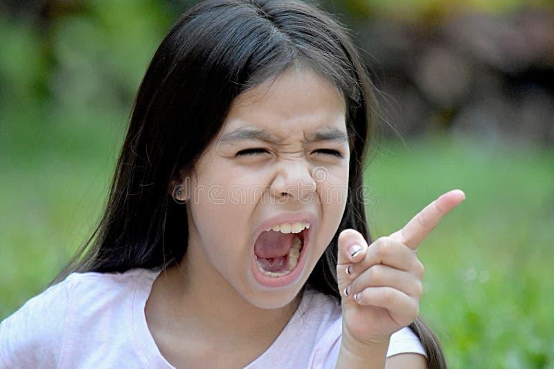 Gullig minoritetTween och ilska royaltyfri bild