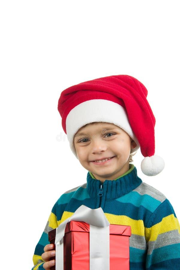 Gullig pojke med den närvarande asken för jul royaltyfria foton