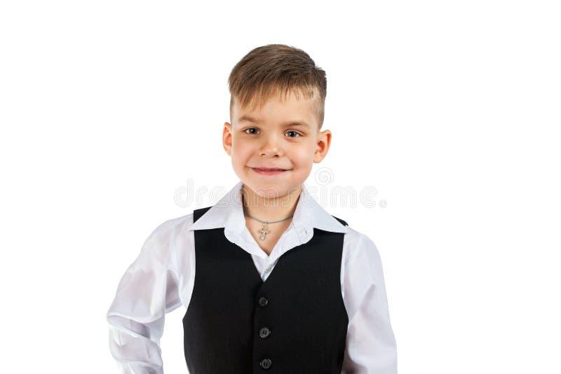 Gullig pys i den vita skjortan och svart sleeveless arkivbilder