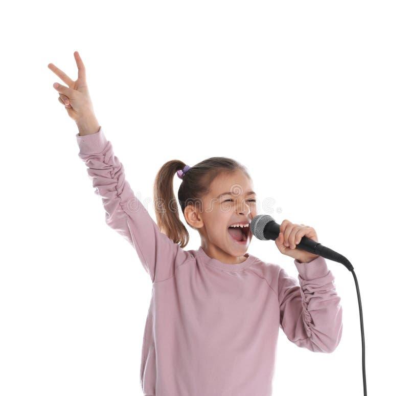 Gullig rolig flicka med mikrofonen royaltyfri fotografi