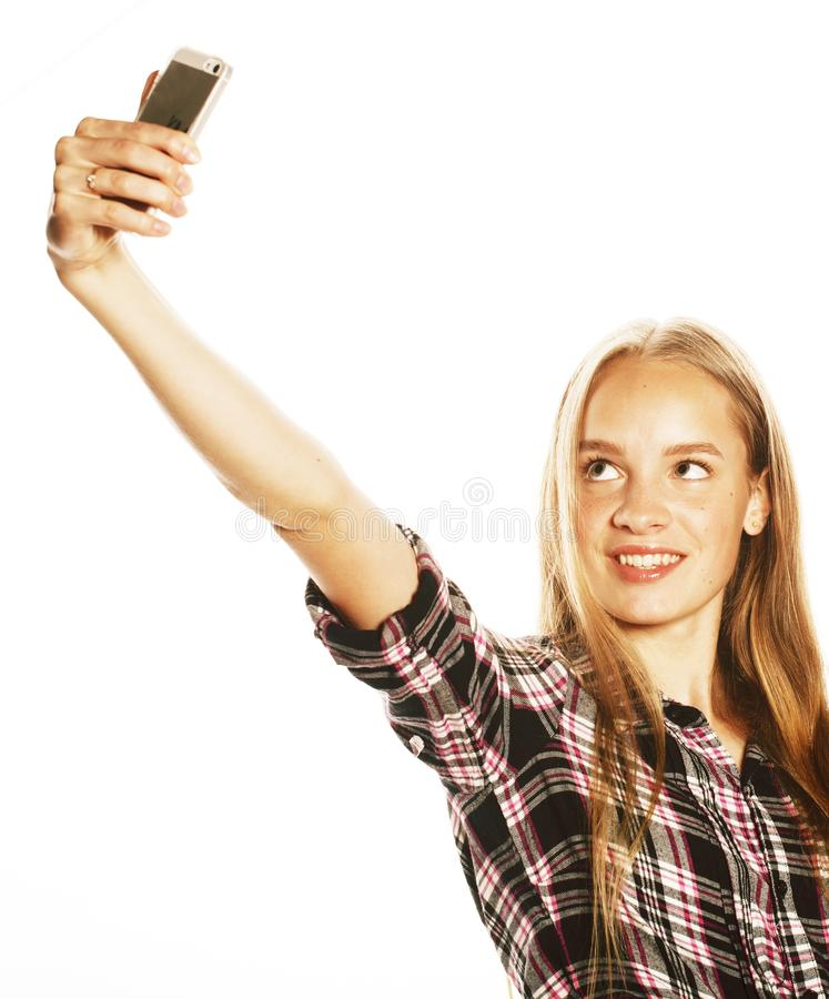 Gulliga tonårs- flickor som gör isolerad selfie arkivbilder