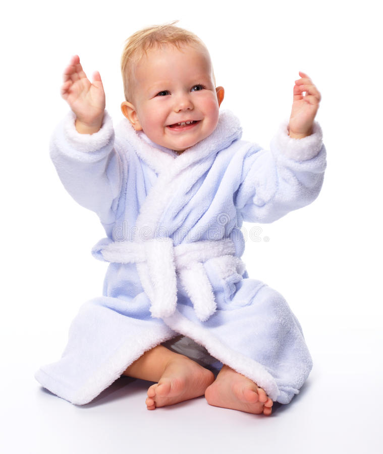 gulligt badrockbarn arkivfoto
