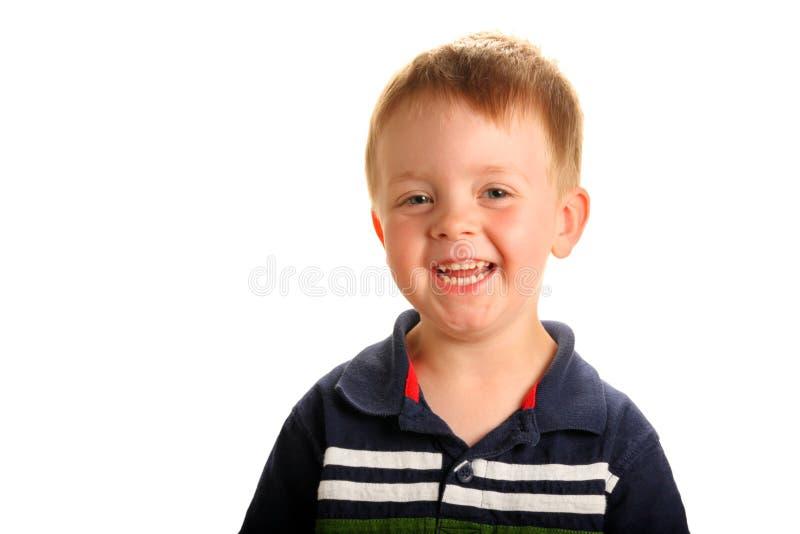 gulligt le för pojke arkivbild