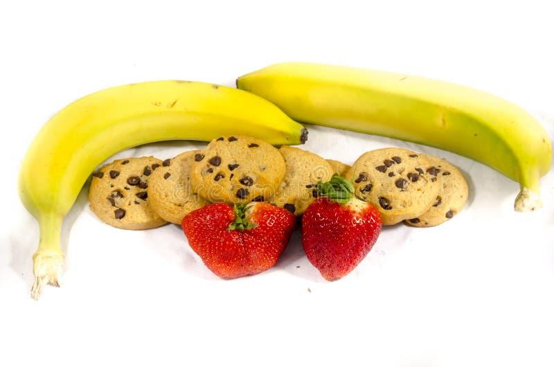 Gulna och göra grön ` s för jordgubben för choklade kakor för banan` s royaltyfri bild
