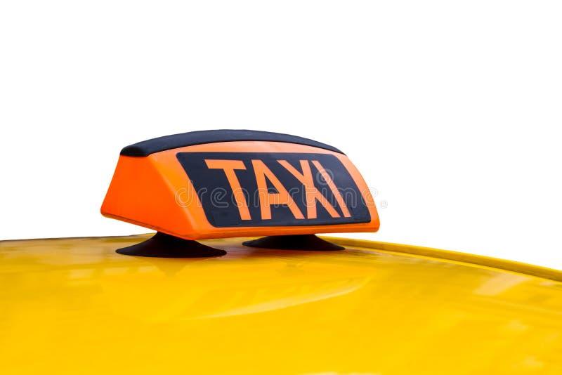 Gult isolerade taxitak och tecken arkivbilder