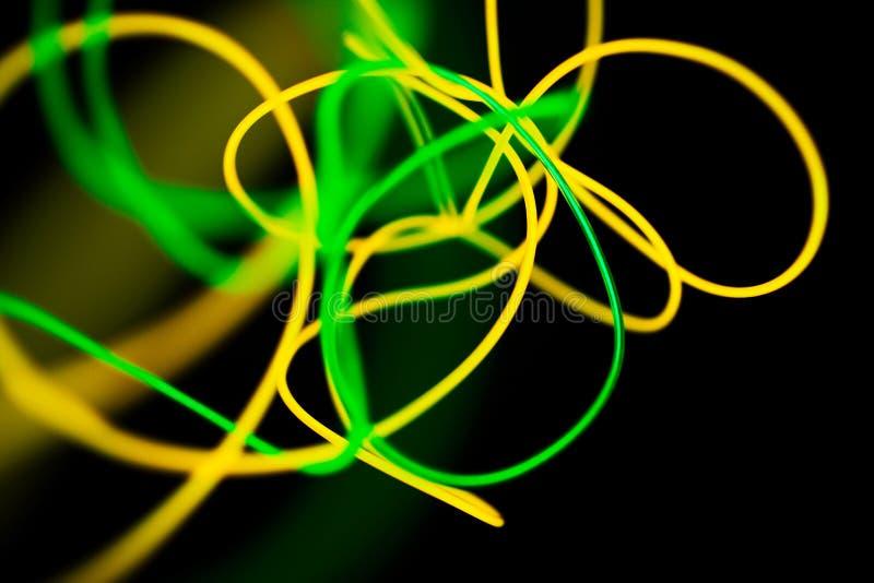 Gult neon och gr?nt neonabstrakt begrepp Neonlinjer fotografering för bildbyråer