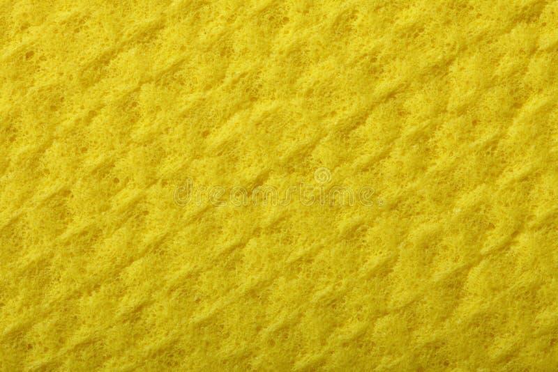 Gult svampskum som bakgrundstextur arkivbilder
