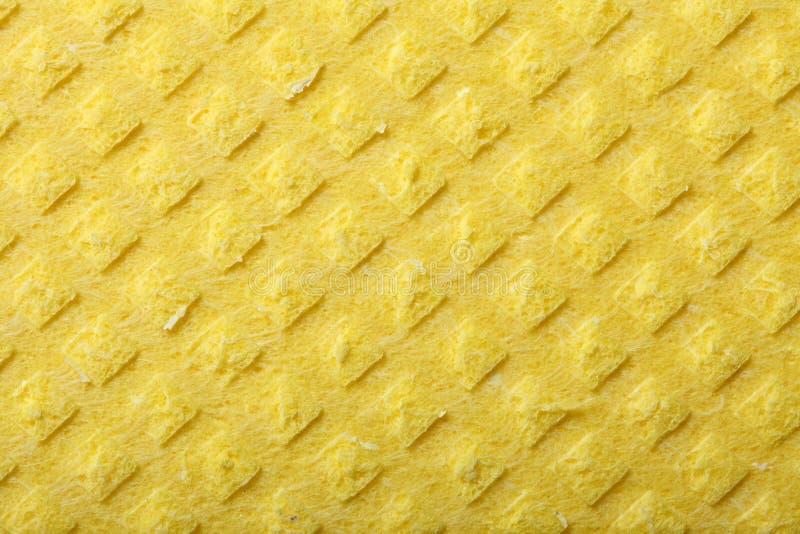 Gult svampskum som bakgrundstextur royaltyfria bilder