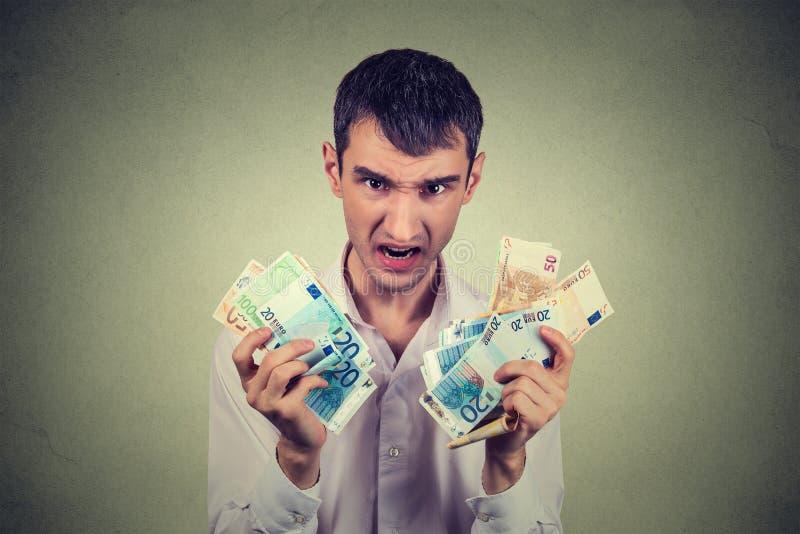 Gulzige mens met euro bankbiljetten royalty-vrije stock afbeelding
