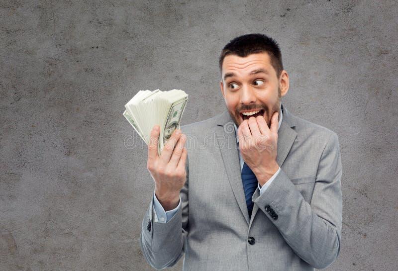 Gulzige zakenman met Amerikaans dollargeld stock foto's