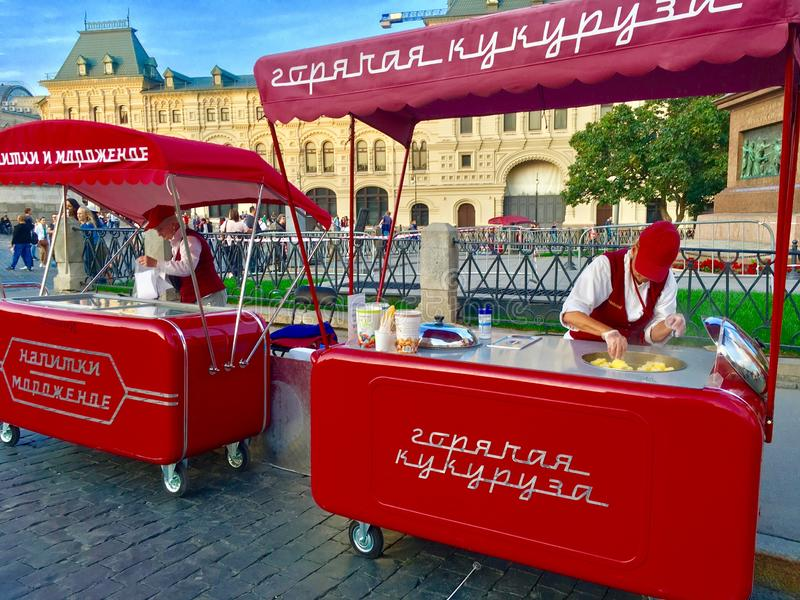 GUM department store, Red Square. GUM department store and street vendors serving hot corn knobs, Red Square, Moscow, Russia royalty free stock photography