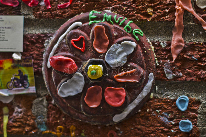 Gum Wall Art. The Market Theater Gum Wall is a local landmark in downtown Seattle, in Post Alley under Pike Place Market. Similar to Bubblegum Alley in San Luis stock image