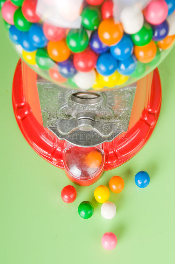 Gumball machine. Colorful gumball in old fashioned machine stock image