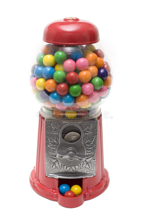 Gumball Machine. A gumball machine filled with multi-colored gumballs. a quarter is in the slot, ready to turn the crank to get more gumballs royalty free stock photos