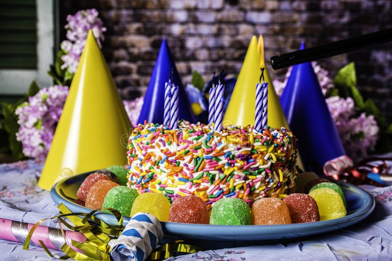 Gumdrops Birthday Cake and Party Favors royalty free stock images
